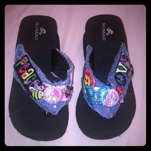 Nomad designer wedgie flip flops